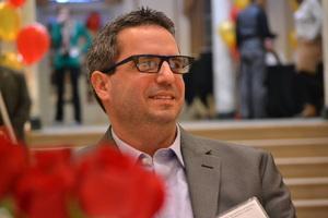 Man attending awards presentation